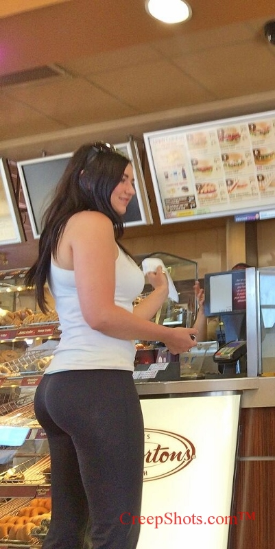 Sexy brunette with a phat ass in black yoga pants