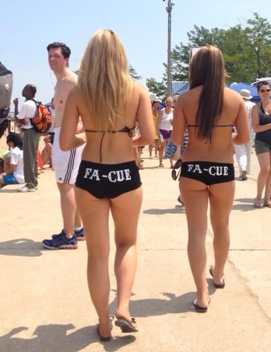 creepshot of two girls with booty shorts walking