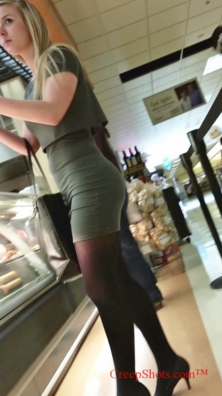 cute blonde in a tight short skirt creep shot